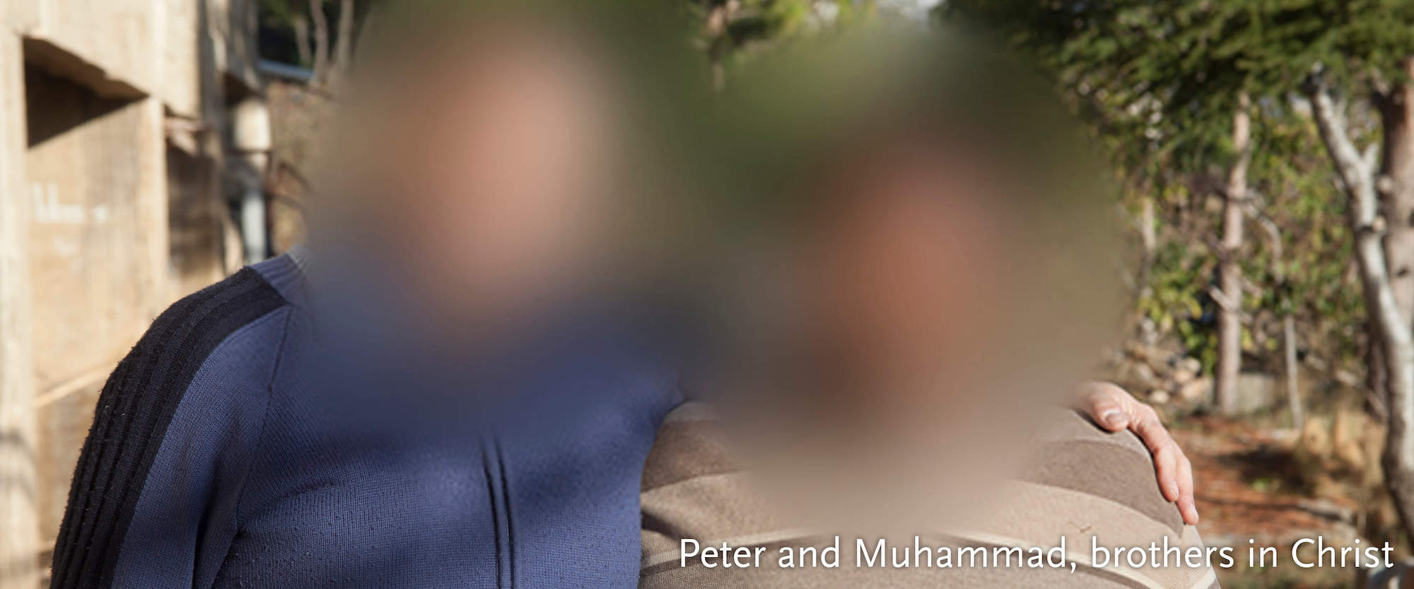 Two Arab men - faces blurred